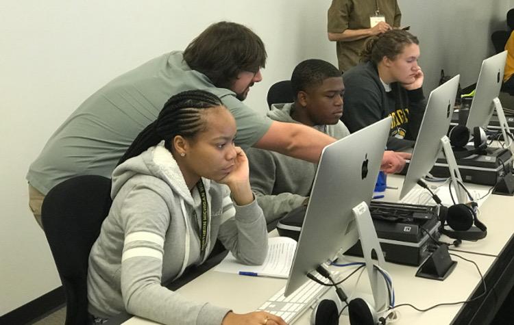 Michael assisting Arcs students