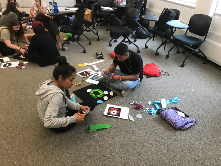 Students making quilt block